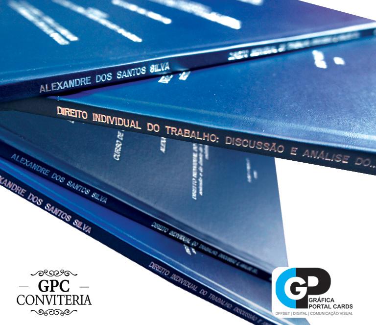 Foto de 04 livros de TCC encadernados com capa azul marinho
